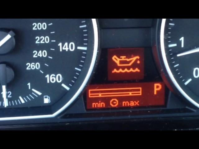 Проверить масло в двигателе в БМВ Х5 е70